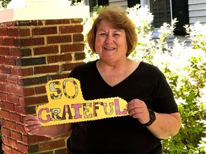 """Dana with a """"so grateful"""" sign"""