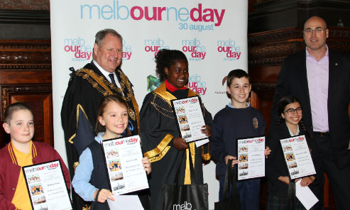 Lord Mayor Robert Doyle and Melbourne Day chairman Campbell Walker in the historic Melbourne Town Hall council chamber with 2014 Junior Lord Mayor competition finalists