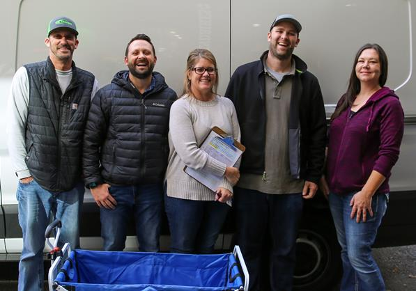 Lease Crutcher Lewis Volunteers deliver food to residents in the Fairfield Apartments