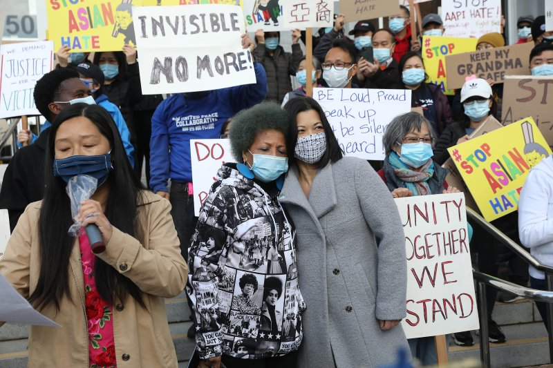 Mattie Scott (center, left to right), founder and Executive Director of Healing 4 Our Families & Our Nation and Nancy Tung, public safety advocate, hold each other as they rally with demonstrators rallying in front of the Hall of Justice as they demand justice for Vicha Ratanapakdee on March 22