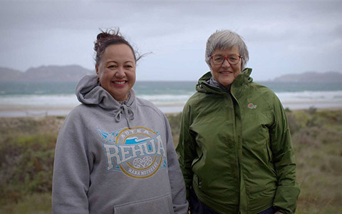 Nicola MacDonald - Ngatir Rehua Ngatiwai ki Aotea and Hon. Eugenie Sage on Whangapoua Beach.