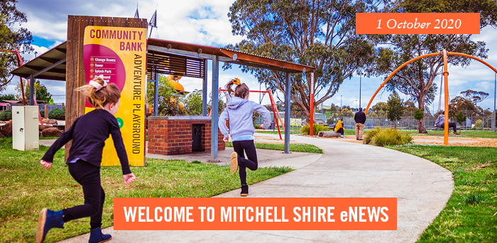 Children running in bright fun park. Sign with words Community Bank Adventure Playground. words. 1 October 2020. Welcome to Mitchell Shire eNews.