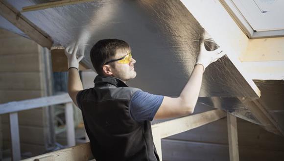 Man installing panelling
