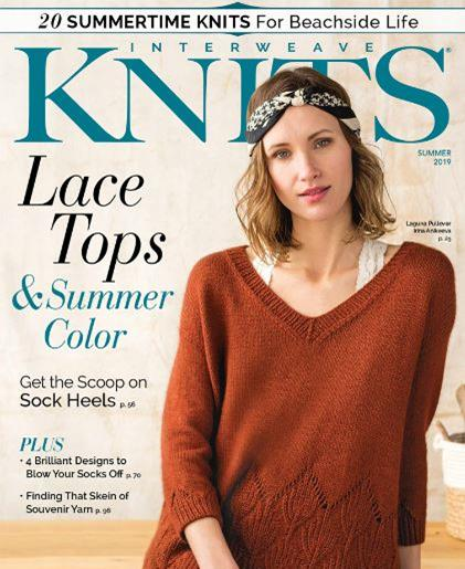 This is the cover image for Interweave Knits summer 2019. The articles include 20 summertime knits for beachside life. Lace tops and summer colour. Get the scoop on sock heels. The image is of a model wearing a v neck pullover with a leaf pattern along the bottom edge.