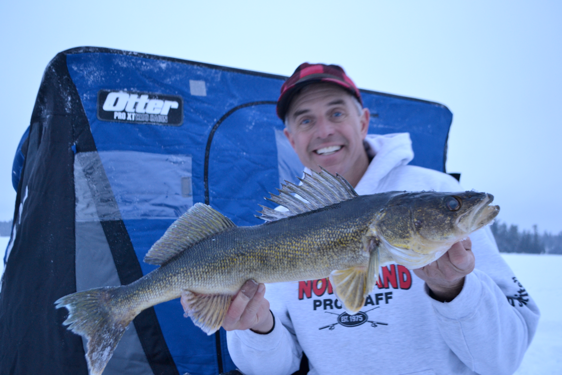 Chip Leer holding a walleye