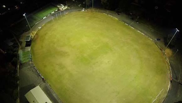 Aerial of oval at night with lights