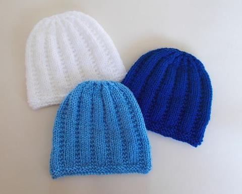 This is an image of three knitted newborn baby hats.