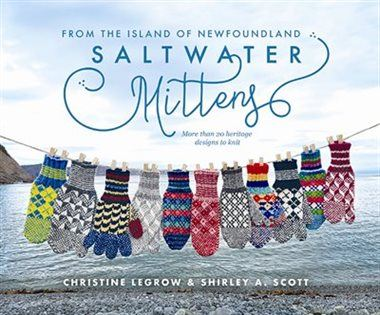 "This is the cover image for the book ""Saltwater mittens from the island of Newfoundland."" The cover image is of a clothesline of colourful mittens hanging in front of a rocky beach with the sea in the background."