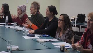 Image of workshop attendees sitting at a table