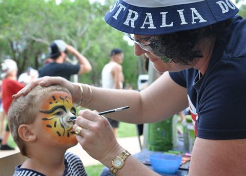 Boy having face painted