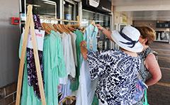 Women looking through clothing racks
