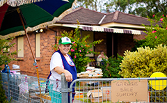 A photo of a resident participating in a garage sale