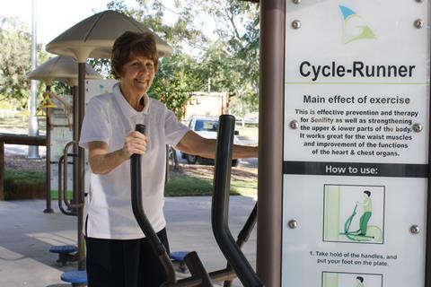 Woman using fitness station equipment