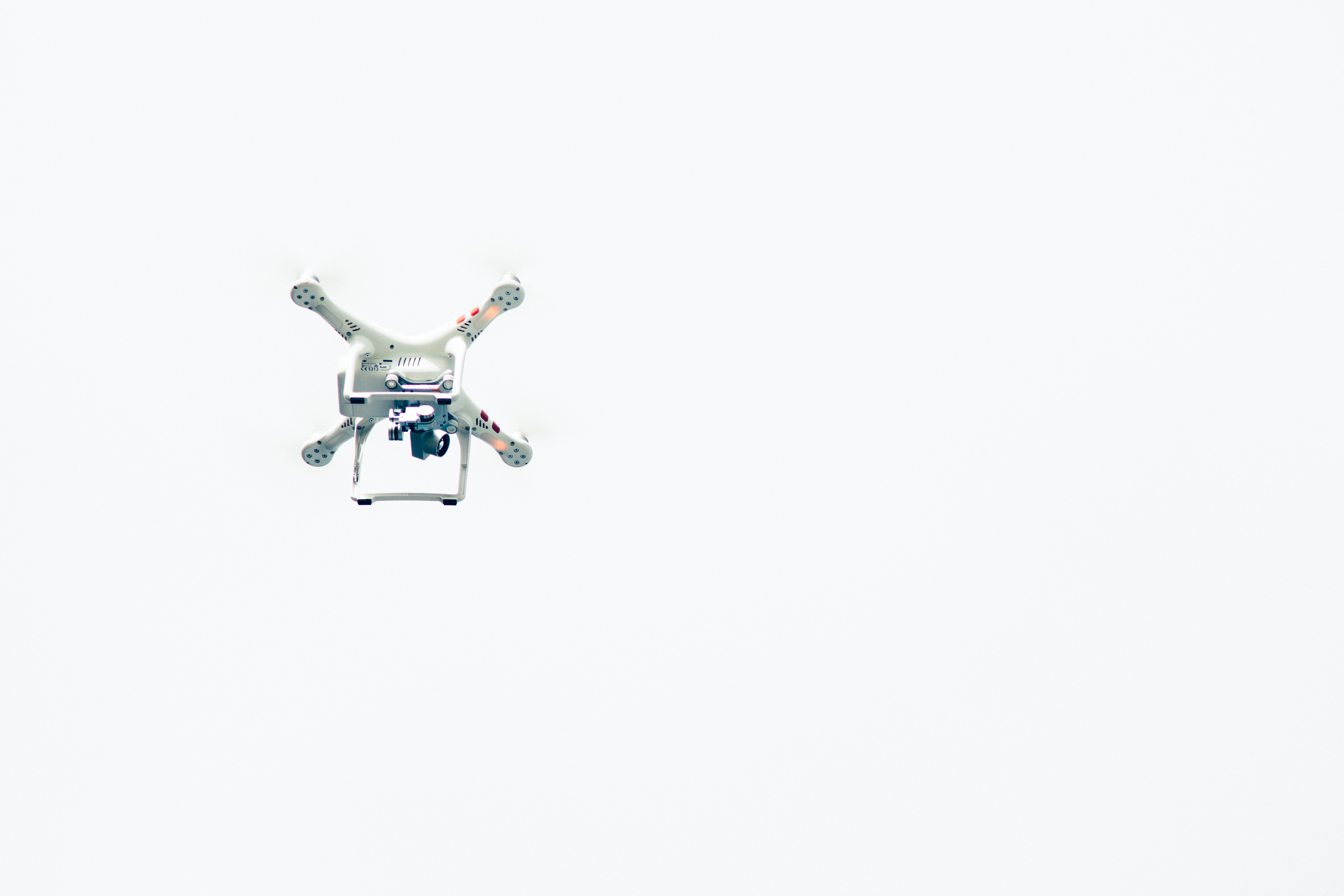 Drone flying against the backdrop of a cloudy sky