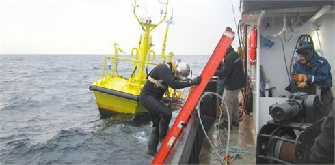Diver prepares to inspect wind research buoy.