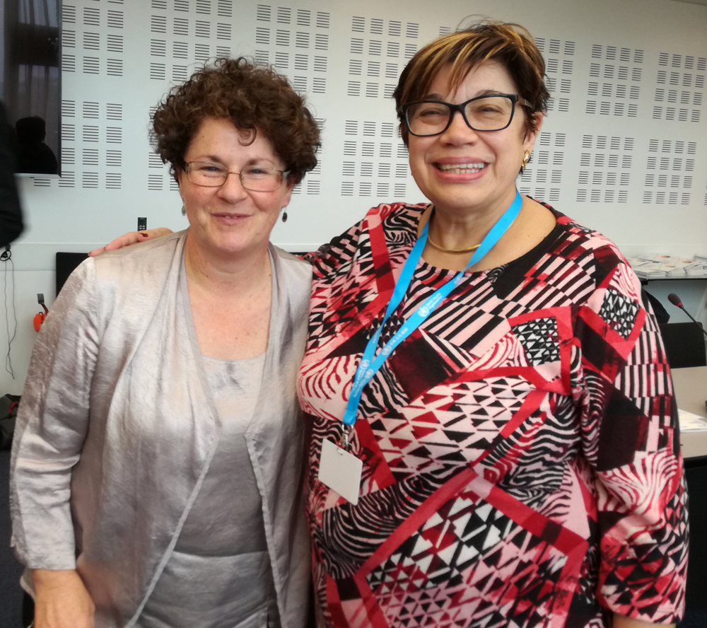 Photo: Teresa Amat (President, EURO-CIU), on the right, with Julie Ligeti (Cochlear) at the World Health Organization