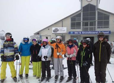 Group of students outside a ski school
