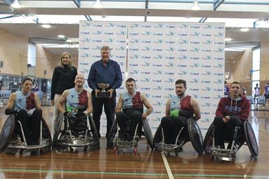 Harlequin wheelchair rugby team being awarded the trophy
