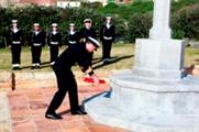 Cdr Russell lays a wreath at Dido Valley Naval Cemetery