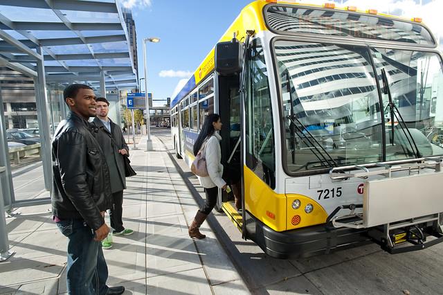 Customers board a bus