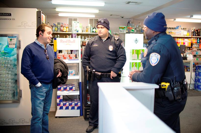 Photo of North Side Community Policing Team speaking with business owner