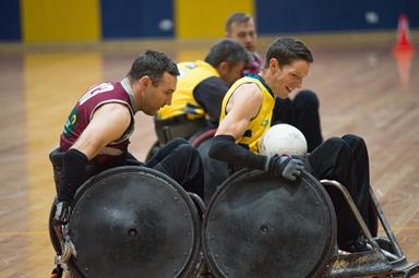 Four men playing wheelchair rugby
