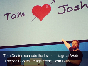 Tom&#32;Coate&#39;s&#32;spreads&#32;the&#32;love&#32;on&#32;stage&#32;at&#32;Web&#32;Directions&#32;South.&#32;Image&#32;credit:&#32;Josh&#32;Clark