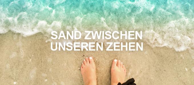 Sand zwischen unseren Zehen