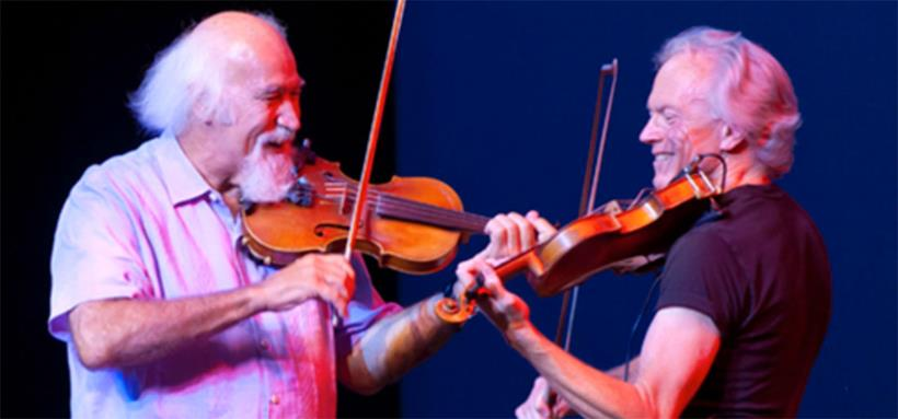 Michael Doucet and Tom Rigney in fiddle harmony
