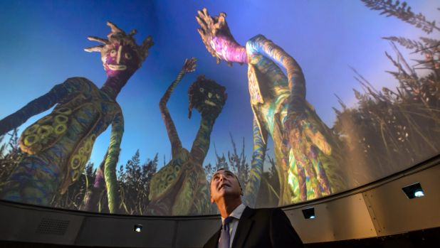 National Museum of Australia director Mathew Trinca immerses himself inside DomeLab. Photo: Sitthixay Ditthavong