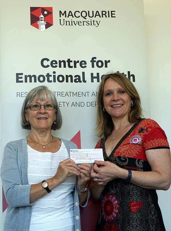 Maggie Alexander, Project Director – North Ryde Fun Run, presenting Jennie Hudson the cheque.