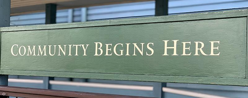 Community Begins Here sign at Phinney Center