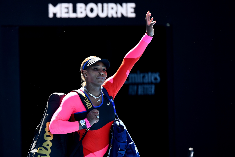 Serena Williams waving to the crowd at the Australian Open