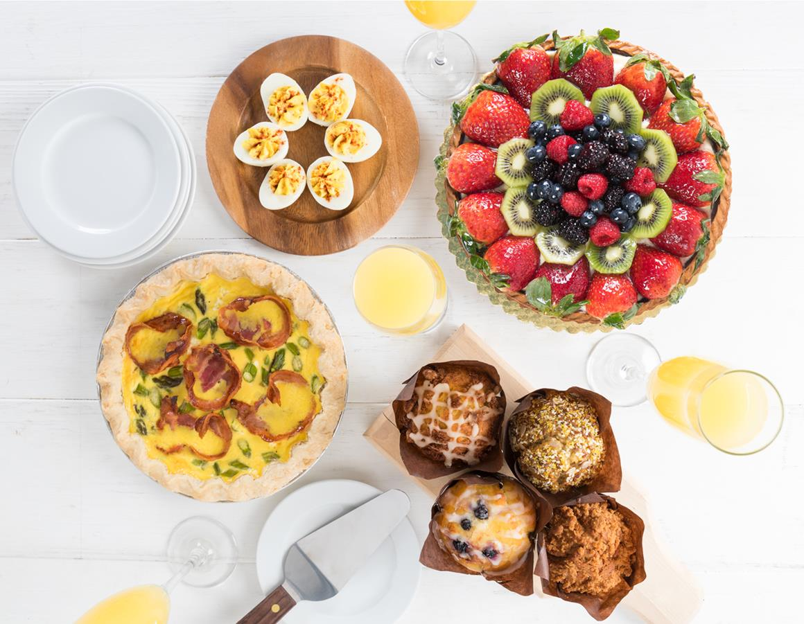 Deviled eggs, fruit tart, quiche and muffins