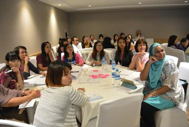 Seminar attendees in Myanmar listen happily