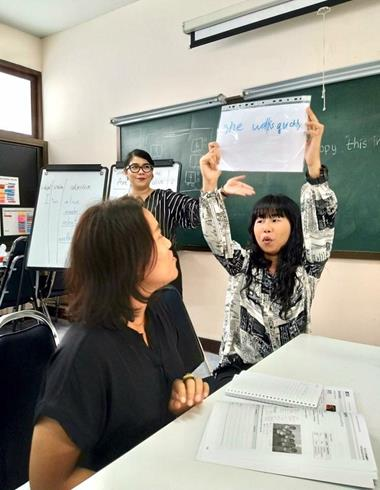 Teachers try out new techniques in class as Kae watches on