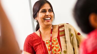 A smiling female teacher