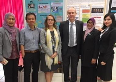 The British Council team stand in front of their posters at the conference