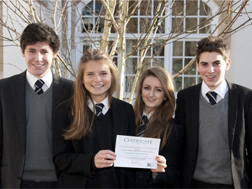 Pupils at Sevenoaks School hold up their first Buy an Acre certificate. © David Merewether.
