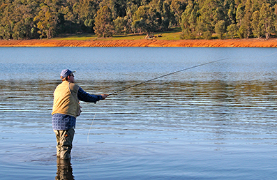 Recreational fisher fly fishing