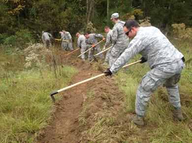 Seymour Johnson AFB firefighters dig a fire line.