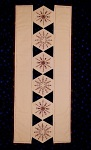 Snowflake double sided table runner designed by Sue Rhodes