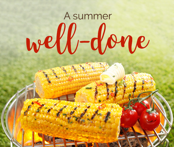 Photo of tomatoes and corn on the cob grilling on a barbecue, topped with butter + Headline: A summer well-done