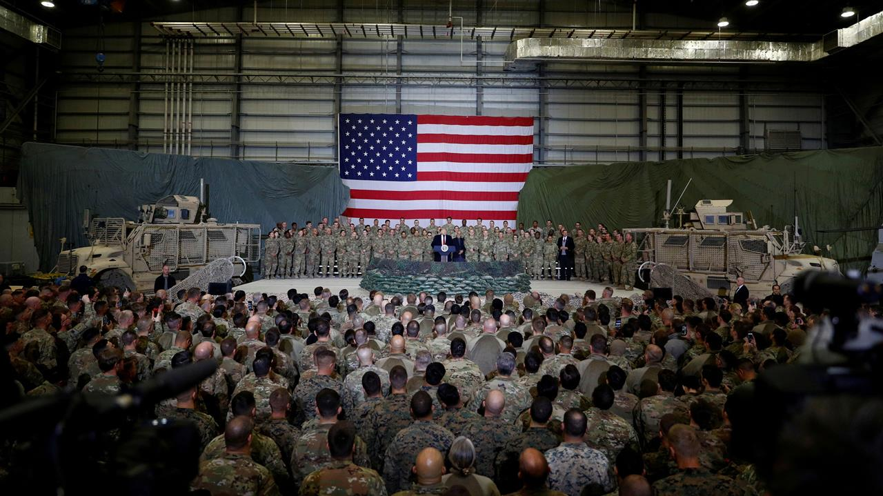 US President Donald Trump delivers remarks to US troops during an unannounced visit to Bagram Air Base, Afghanistan, November 28, 2019.