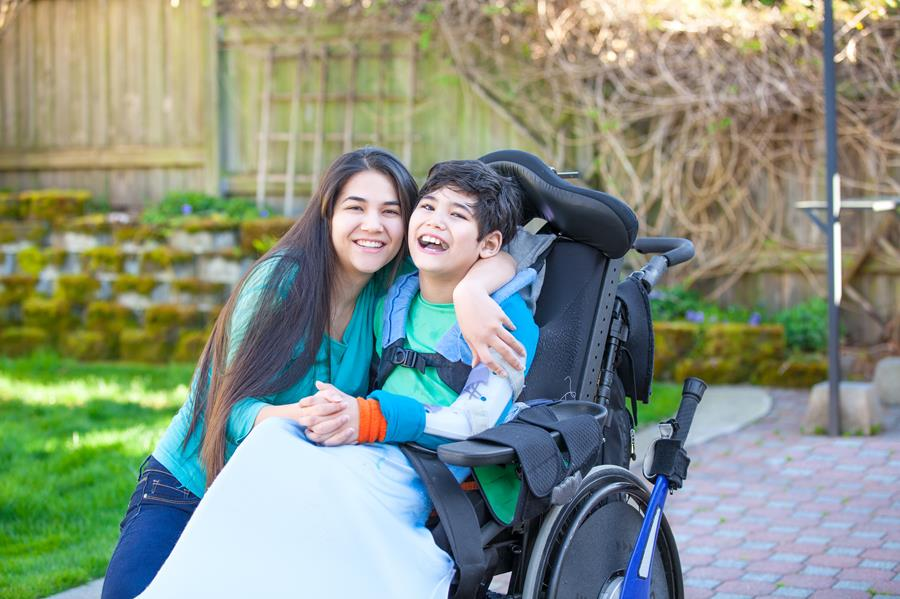 Woman with boy in wheelchair