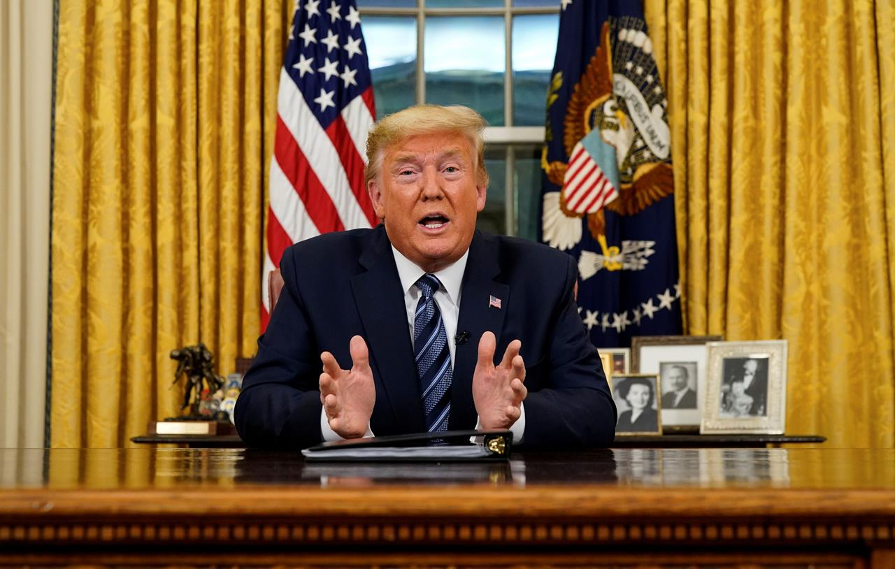 US President Donald Trump speaks about the US response to the COVID-19 coronavirus pandemic during an address to the nation from the Oval Office of the White House in Washington, DC, March 11, 2020.