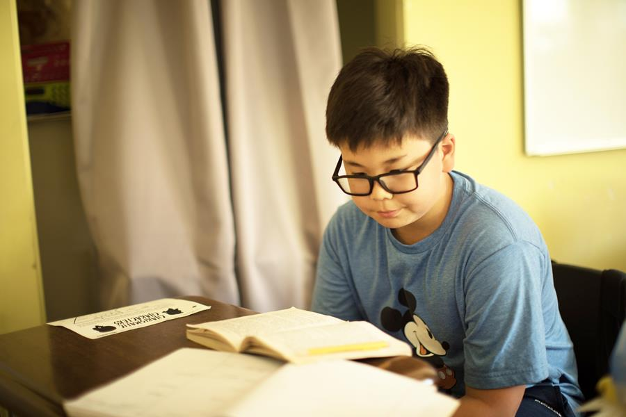 young male student reading a book