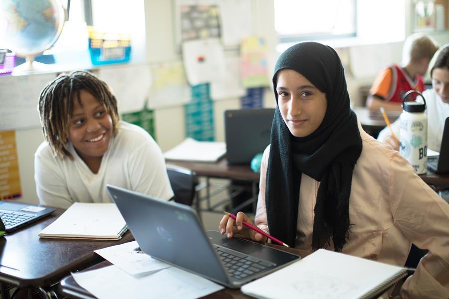 Female teacher leading a class discussion