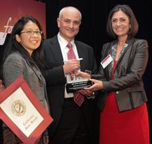 Linda Starr (right) presents Shearman & Sterling with the Pro Bono Award. Accepting the award are Jim Donato and Jiyoun Chung.
