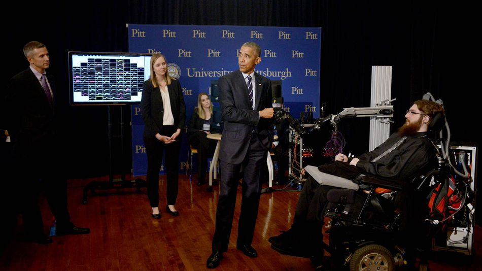 President Obama fist-bumps Nathan Copeland's robotic hand. (Michael Henninger/Pittsburgh Post-Gazette via AP)